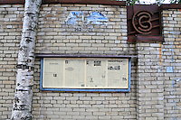 News on the wall outside a St. Petersburg factory.