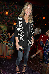 KIM HERSOV at a party hosted by fashion website Farfetch to launch i.am + EPs headphones hosted by Will.i.am at Loulou's, 5 Hertford Street, London on 16th September 2016.