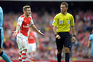 Arsenal's Jack Wilshere angry with Referee Mark Clattenburg decsion to award Manchester City a free kick. Barclays Premier league match, Arsenal v Manchester city at the Emirates Stadium in London on Saturday 13th Sept 2014.<br /> pic by John Patrick Fletcher, Andrew Orchard sports photography.