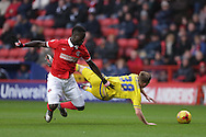 Mouhamadou-Naby Sarr of Charlton Athletic fouls Ben Osborn of Nottingham Forest. Skybet football league championship match, Charlton Athletic v Nottingham Forest at The Valley  in London on Saturday 2nd January 2016.<br /> pic by John Patrick Fletcher, Andrew Orchard sports photography.