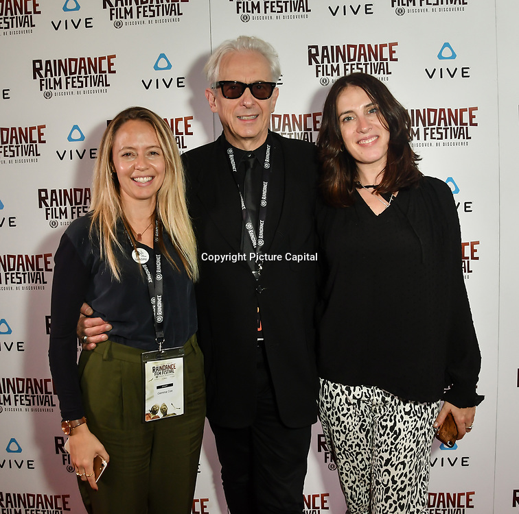 Gemma Cox and Katy Driscoll with Elliot Grove (M) the Raindance  team attends the Raindance Film Festival - VR Awards, London, UK. 6 October 2018.