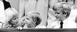 Zara Phillips, Prince William, and Peter William on the balcony of Buckingham Palace, London during the Queen's birthday parade.