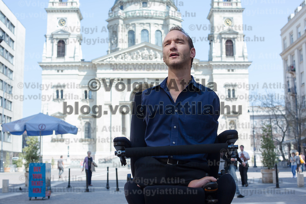 Nick Vujicic born without legs and arms takes a walk in the city centre after a press conference during his visit to deliver his teachings about hope in Budapest, Hungary on April 18, 2013. ATTILA VOLGYI