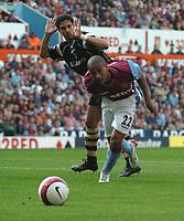 Photo: Ian Hebden.<br />Aston Villa v Charlton Athletic. The Barclays Premiership. 23/09/2006.<br />Villa's Luke Moore (R) bustles past Charlton's Talal El Karkouri (L).