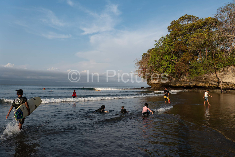 Indonesian tourists at Batu Karas beach on the 31st October 2019 in Java in Indonesia.