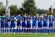 Bristol Rovers take part in a minutes silence for ex Chief Executive Gordon Bennett during the EFL Sky Bet League 1 match between Bristol Rovers and Ipswich Town at the Memorial Stadium, Bristol, England on 19 September 2020.