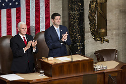 January 30, 2018 - Washington, District Of Columbia, U.S. - United States Vice President MIKE PENCE, left, and Speaker of the United States House of Representatives PAUL RYAN, Republican of Wisconsin, right, stand as United States President DONALD J. TRUMP enters the Senate Chamber prior to delivering the State Of The Union Address at the United States Capitol. (Credit Image: © Alex Edelman via ZUMA Wire)