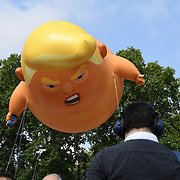 Trump 'baby' blimp fly over Parliament Square Gardens on July 2018, London, UK.