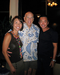 Wildlife photographer Steve Drogin and his wife Hiro along with photographer, Masa Ushioda, Kona, Big Island, Hawaii, USA