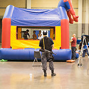 A man stands near the children's play area at HeroesCon, an annual independat comic convention, in Charlotte, NC