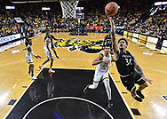 Cincinnati Bearcats guard Jarron Cumberland (34) drives in for a lay up past Wichita State Shockers forward Jaime Echenique (21) during the second half at Charles Koch Arena. Mandatory Credit: Peter G. Aiken/USA TODAY Sports
