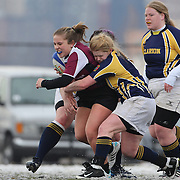 Caroline Nickels, Molloy College is tackled during the Clarion Vs Molloy Women's College Division game at the Four Leaf 15s Rugby Tournament which attracted over 60 clubs teams from New York and Interstate held at Randall's Island Park, New York, USA. 21st March 2015. Photo Tim Clayton
