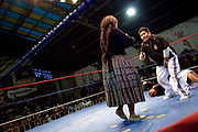Referee grabbing his crotch in front of female wrestlers. Lucha Libre wrestling origniated in Mexico, but is popular in other latin Amercian countries, including in La Paz / El Alto, Bolivia. Male and female fighters participate in the theatrical staged fights to an adoring crowd of locals and foreigners alike.