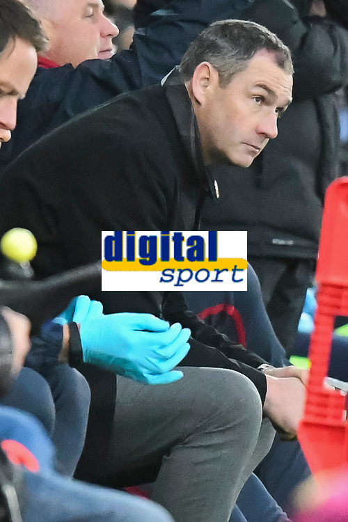 Football - 2017 / 2018 Premier League - Swansea City vs. Brighton & Hove Albion<br /> <br /> Swansea City manager Paul Clement sits on the bench as his team head for defeat , at The Liberty Stadium.<br /> <br /> COLORSPORT/WINSTON BYNORTH