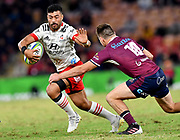 Richie Mo'unga (left) of the Crusaders gets past James O'Connor (right) of the Reds during the Round 2 Trans-Tasman Super Rugby match between the Queensland Reds and the Canterbury Crusaders at Suncorp Stadium in Brisbane, Saturday, May 22, 2021. (AAP Image/Darren England) NO ARCHIVING, EDITORIAL USE ONLY