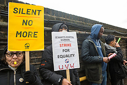 London, UK. 29 October, 2019. Outsourced workers belonging to the United Voices of the World (UVW) trade union protest outside the office of the Chief Executive of Imperial College Healthcare NHS Trust Professor Tim Orchard at St Mary's Hospital Paddington. Around 200 migrant cleaners, porters and caterers outsourced via Sodexo, one of the world's largest multinational corporations, are striking for equal pay, conditions and treatment with broadly equivalent NHS colleagues who are paid £6,000-10,000 p.a. more and have scheduled 12 days of strike action.