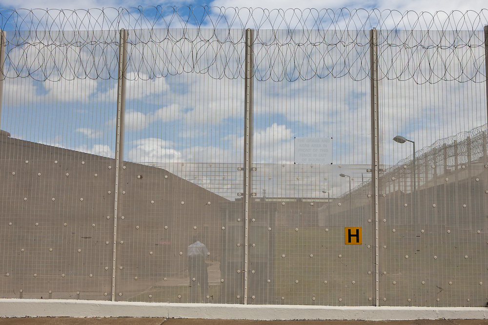 Aescurity fence in the grounds of the prison. HMP The Mount, Bovingdon, Hertfordshire