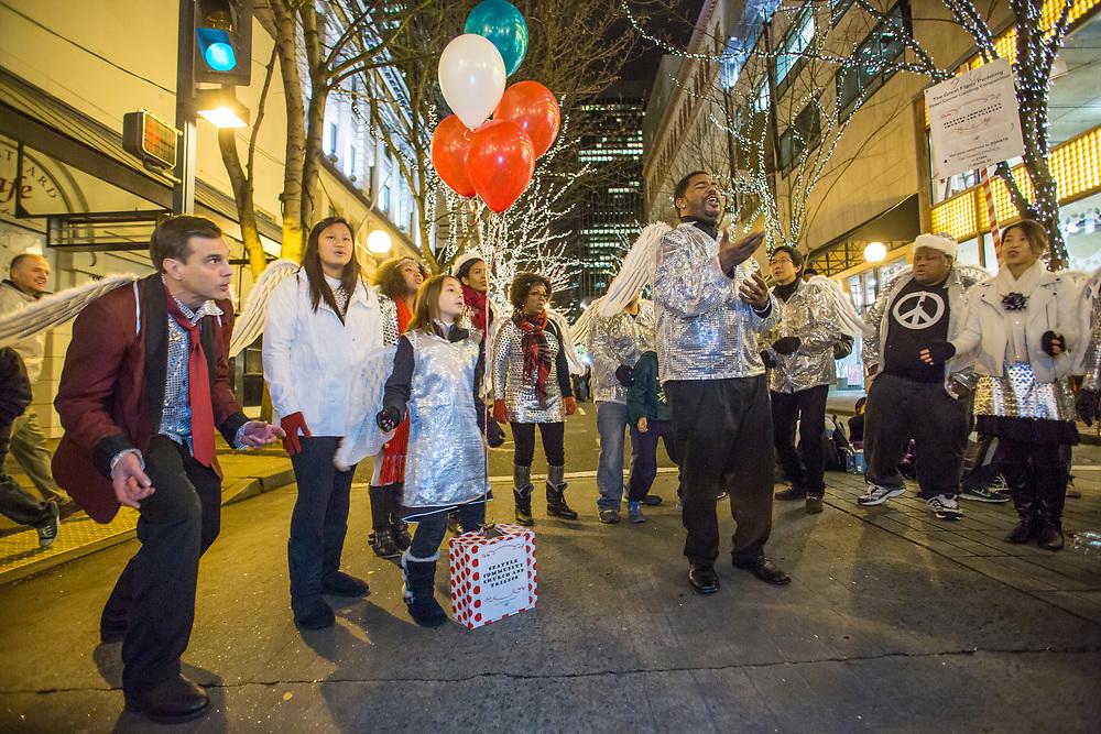 North America, Washington, Seattle, Great Figgy Pudding Street Corner Caroling Competition.  MR