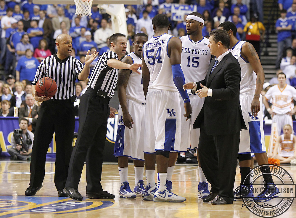 Official Doug Sirmons moved the Kentucky team off the court as they huddled after a double technical foul call as Kentucky defeated Tennessee 74-45 on Saturday March 13, 2010 in Nashville, Tn. Photo by Mark Cornelison oe Staff.