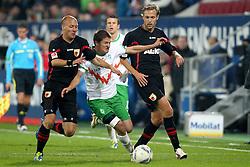 21.10.2011, SGL Arena, Augsburg, GER, 1.FBL, FC Augsburg vs. Werder Bremen, im Bild Dominik Reinhardt (Augsburg #4) Aleksandar Ignjovski (Bremen #17) und Daniel Brinkmann (Augsburg #24)  // during the FC Augsburg vs. Werder Bremen , on 2011/10/21, SGL Arena, Augsburg, Germany, EXPA Pictures © 2011, PhotoCredit: EXPA/ nph/  Straubmeier       ****** out of GER / CRO  / BEL ******