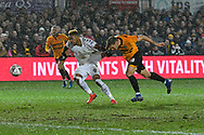 Britt Assombalonga (9) of Middlesbrough battles for possession with Mickey Demetriou of (28) of Newport County during the The FA Cup match between Newport County and Middlesbrough at Rodney Parade, Newport, Wales on 5 February 2019.