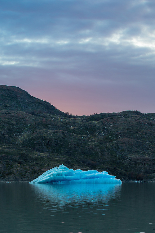 A lone iceberg silently floats in Lago Grey.