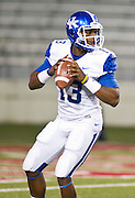 Kentucky Wildcats quarterback Jalen Whitlow (13) looks to make a pass during the first half of a game against the Arkansas Razorbacks at Donald W. Reynolds Razorback Stadium in Fayetteville, Ark., on Oct.. 13, 2012. Photo by Beth Hall
