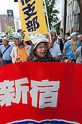 Japanese people march for workers' rights and to protest against some of Prime Minister Shinzo Abe's policies during the May Day Rally in Tokyo, Japan. Friday May 1st 2015