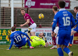 06MAR21 Queen of the South's James Maxwell (right) scoring their second goal. half time : Arbroath 2 v 3 Queen of the South, Scottish Championship played 6/3/2021 at Arbroath's home ground, Gayfield Park.