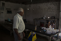 October 9, 2016 - Boa Viagem, Brazil - Occasionally Mr. José receives a visit from his family, but he said it is very rare that this to happen.  José Belmiro dos Santos is 84 years old, married to Rosalia Maria da Conceição and has nine children. He is retired since 1997 and works in a parking taking care of vehicles. The parking lot is situated in an abandoned building in Boa Viagem, in Recife, Pernambuco state, Brazil.Mr. José has to live in the building and can only visit family once a month. He thinks it's dangerous, because the parking lot is located inside a slum, but need to earn cash and stay home another person can take his job.Mr. José is part of a national statistic that indicates an increase in the number of pensioners who return to work in Brazil, 5.9% in the first quarter of 2012 to 6.5% in the second quarter 2016 (data from the Brazilian Institute of geography and Statistics), due to the current economic crisis.The government of the current President Michel Temer has as one of the goals the approval of Welfare Reform, thus ensuring clearer rules for retirement and the increase in the contribution to the public coffers. The approval of new rules for retirement might take the Brazil of the crisis and increase a government approval rating scored by polemics and an impeachment questioned by the opposition. (Credit Image: © Diego Herculano/NurPhoto via ZUMA Press)