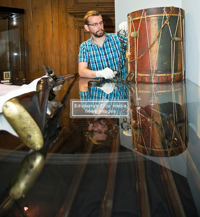 Pictured: <br /> <br /> The latest Museum of Edinburgh exhibition documents the history of Edinburgh's Town Guard, which brought law and order to the city in the 18th century. Curator Nico Tyack and Museum Assistant David Mclay examined muskets, halberds and drums before the exhibition was opened to the public<br /> <br /> Ger Harley | EEm 15 June 2017