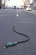 Broken gas pump in the street
