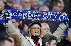 Cardiff City fan holds up a scarf. - Photo mandatory by-line: Alex James/JMP - Tel: Mobile: 07966 386802 03/11/2013 - SPORT - FOOTBALL - The Cardiff City Stadium - Cardiff - Cardiff City v Swansea City - Barclays Premier League