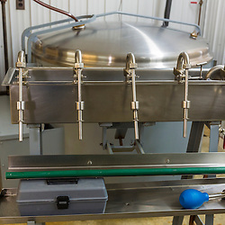 Small batches of syrup are hand-bottled with this device at Maine Maple Products in Madison, Maine. The majority of the syrup bottled here is harvested in Big Six Township, Maine.