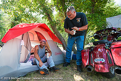 Byron Buathier of Indianapolis, IN (in the tent door) and Bob Glos of Plainfield, IL at Glencoe Campground during the annual Sturgis Black Hills Motorcycle Rally. SD, USA. August 7, 2014.  Photography ©2014 Michael Lichter.