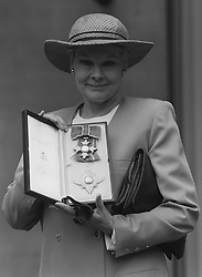Britain's newest Dame, Judi Dench, at Buckingham Palace after receiving her DBE from the Queen.