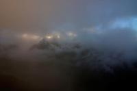 Mount Krivàn (2495 m asl), national symbol of Slovakia. The massif with Mount Hruba Kopa (2238 m asl) in fog. High Tatras, Slovakia. June 2009. Mission: Ticha