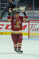 REGINA, SK - MAY 27: Samuel Asselin #28 of Acadie-Bathurst Titan hoists the Memorial Cup after the win against the Regina Pats at the Brandt Centre on May 27, 2018 in Regina, Canada. (Photo by Marissa Baecker/CHL Images)