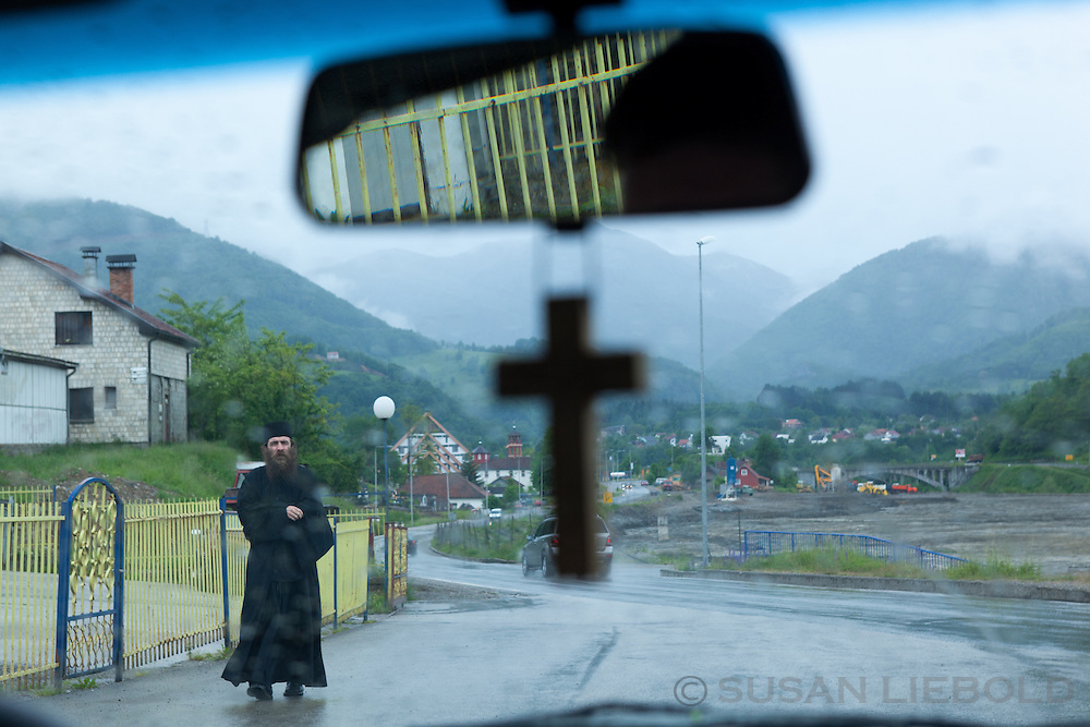 Looking out windshield with a cross hanging on the rearview mirror in Montenegro.
