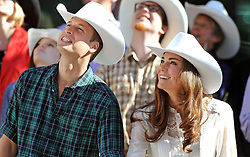 File photo dated 08/07/11 of the Duke and Duchess of Cambridge wearing matching Stetson hats during the Calgary Stampede parade in western Canada. The Duchess of Cambridge will have spent a decade as an HRH when she and the Duke of Cambridge mark their 10th wedding anniversary on Thursday. Issue date: Wednesday April 28, 2021.