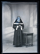 broken glass plate with studio portrait of a nun with a blue face France ca 1920s