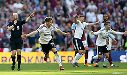 Fulham's Tom Cairney (second left) celebrates promotion after the final whistle during the Sky Bet Championship Final at Wembley Stadium