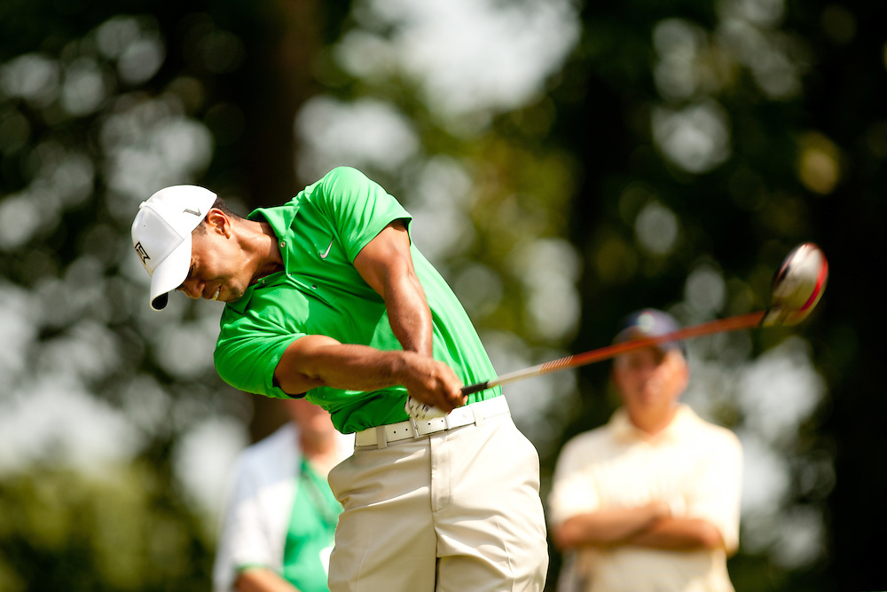 BETHESDA, MD - JUNE 30: Tiger Woods plays a tee shot during the third round of the 2012 AT&T National at Congressional Country Club in in Bethesda, Maryland on June 30, 2012. (Photograph ©2012 Darren Carroll) *** Local Caption *** Tiger Woods