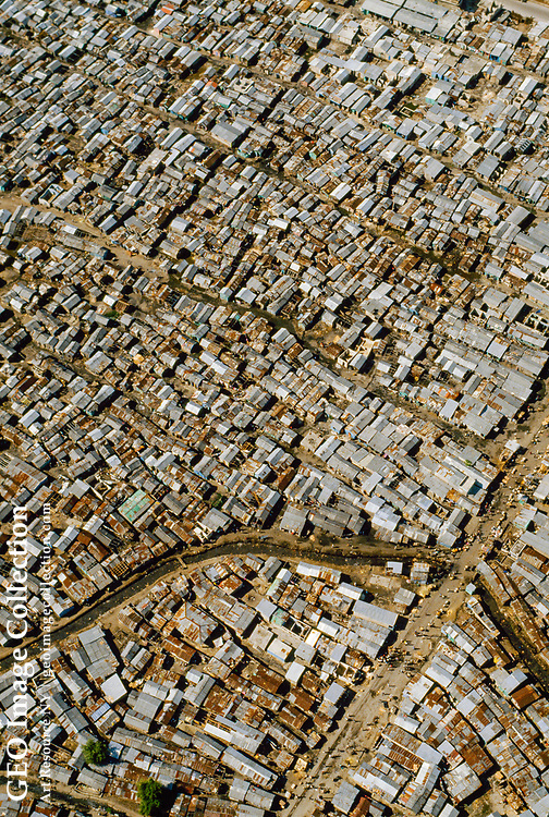 Aerial views of poverty with dilapidated and decayed houses crowded together in poor ghetto in LES CAYES, HAITI.