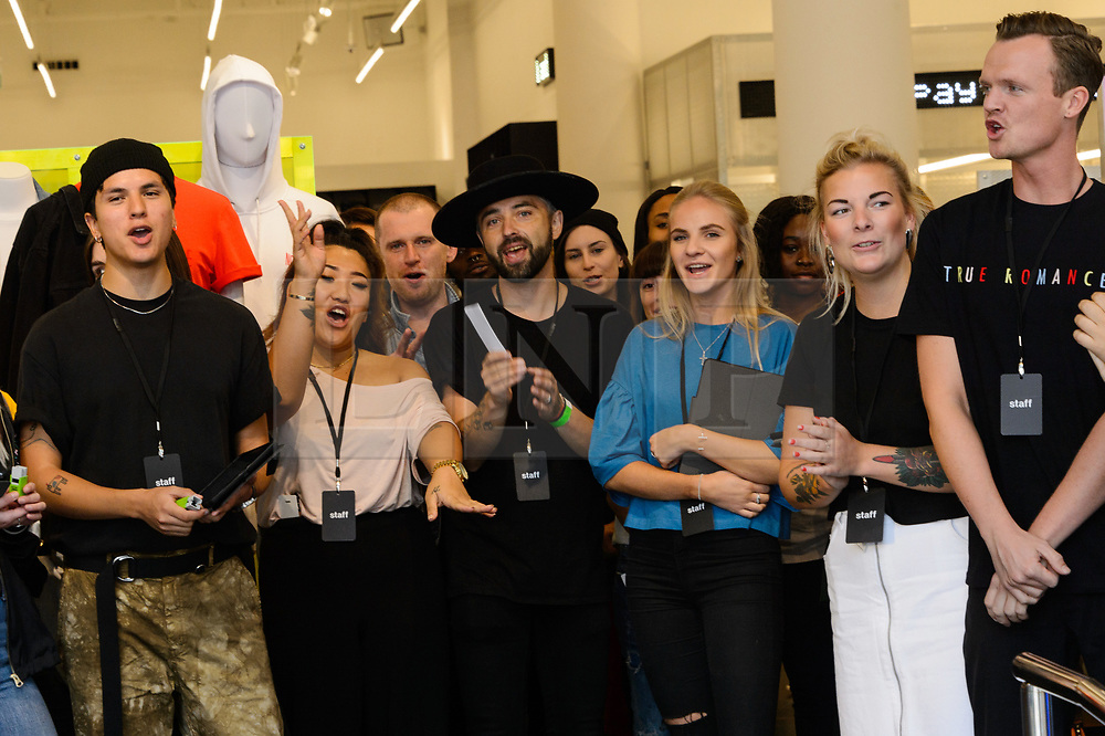 © Licensed to London News Pictures. 18/08/2017. London, UK. Store staff at the opening of H&M group's first Weekday clothing store in Regent Street. Weekday is know for its offerings and minimalist styles, with 27 stores throughout Europe. The store is next to the H&M Arket lifestyle store. Photo credit: Ray Tang/LNP