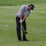 Bubba Watson, USA, hits his approach shot on the 9th during the first round of the Travelers Championship at the TPC River Highlands, Cromwell, Connecticut, USA. 19th June 2014. Photo Tim Clayton