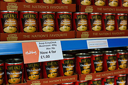 "© Licensed to London News Pictures. 19/12/2014. London, UK. Tins of Heinz soup on display in the Community Shop costing £1 for four tins. The Community Shop opened this week in Gipsy Hill, South London and is a ""social supermarket"", which sells heavily-discounted surplus food that would otherwise be thrown away. Food is received from retail brands such as Marks & Spencer, Asda, Tesco, Innocent and Muller and many more. The shop works on a membership basis only, serving residents who are on income support and aimed at people who are in work, but low waged and for those working hard to find a job. Photo credit : Vickie Flores/LNP"