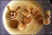 Brilliant breakfast: Pancake artist recreates famous paintings, 3D animals and replicas of food with pancake batter and syrup<br /> <br /> One cook has turned his kitchen into his studio, creating artworks with a breakfast serving of pancakes.<br /> What started as simple shapes made from pancake batter to amuse his children has turned into three-dimensional sculptures and replicas of famous artworks.<br /> Michael Goudeau spends hours creating edible art, sharing photographs of his pancake masterpieces on his blog before it is gobbled up for breakfast in what he calls his 'madness'.<br /> <br /> On his blog The Pancake Project, the 53-year-old calls himself a 'pancake artist' and that 'the time has come to reveal my madness'.<br /> Breakfast never looked so artistic, with pancake batter whipped into replicas of other foods such as tacos, steak and chips, Christmas trees or a mouse caught in a trap complete with red syrup to show his sticky end.<br /> <br /> Artist Edvard Munch would surely be licking his lips had he seen Mr Goudeau's attempt to recreate his famous painting The Scream.<br /> <br /> Mr Goudeau, a professional juggler from Las Vegas, Nevada said: 'I make pancakes for breakfast for my children Emily, 10, and Joey, 12.<br /> 'This started when they were very young. I wanted to make something that would get them excited about eating so I made the first letter of each of their names.<br /> 'They loved them and their excitement led me to up my game.'<br /> The pancake artist uses a bottle with a nozzle to pipe intricate sections and adjusts the cooking heat to control the colour and texture of the batter.<br /> He said: 'I put the batter into a squeeze bottle, and I found I could do letters and easy shapes and designs.<br /> 'For the first couple of years I only worked with getting different tones of brown by timing the placement of different parts of the batter.<br /> <br /> 'The next step into crazy was the idea that I could make a three dimensional panc