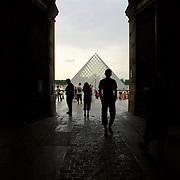 tourist walking towards Louver's courtyeard