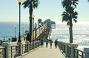 Tourists Walking on the Oceanside Pier on a Late Afternoon